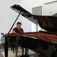 TJ offering Palm Beach Garden Piano Tuning and Service